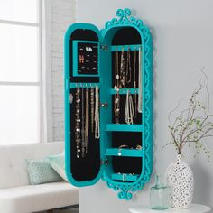 Belham Living Wall Scroll Locking Jewelry Armoire - Turquoise - Indulge your love of shabby chic with the Belham Living Wall Scroll Locking Jewelry Armoire - Turquoise. Crafted form MDF wood and wood veneers and fi...