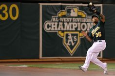 CrowdCam Hot Shot: Oakland Athletics center fielder Michael Choice catches the foul ball against the Los Angeles Angels during the ninth inning at O.co Coliseum. The Los Angeles Angels defeated the Oakland Athletics 12-1. Photo by Kelley L Cox