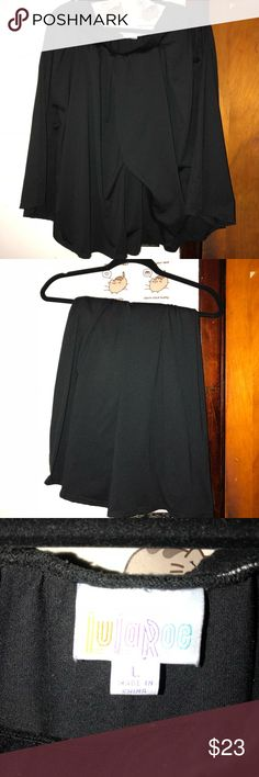 LuLaRoe Madison L *BLACK* Super soft stretchy Madison (skirt with pockets) in size large BLACK. Worn and washed once. LuLaRoe Skirts
