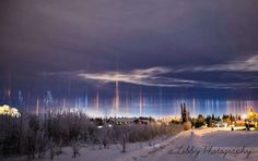 This nearby beautiful rare phenomenon that can appear as a distant one, are not auroras but light pillars. Image credit Allisha Libby.  A lucky viewer can see a Sun-pillar, a column of light appearing to extend
