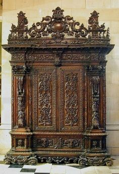 Walnut Armoire purchased from T. Gagliardi of Florence, and the bill describes it as follows: '1 large antique walnut armoire from the Ducal House of Parma'. Its heavily carved decoration includes carved and pierced scrolls, fruit and flowers, egg-and dart, acanthus, and scrolling foliage which form handles to the lower and side drawers. Italy ca 1700