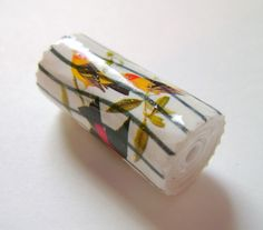 Gorgeous hand rolled postage stamp bead by Angela's Paper Art