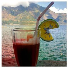 Every day in Bali I've been enjoying drinking fresh juice at every opportunity. Today was the first time I drank a Kintamani Juice which was a blend of tamarillo lime and orange. Quite tart but refreshing. Was able to sip while enjoying the amazing view of Bukit Abang at Kintamani. Later we sat in the thermal hot spring water which is meant to have healing qualities. Such a lovely day in Bali! #holidays #bali #indonesia #kintamani #fresh #yum #delish #peace #relax