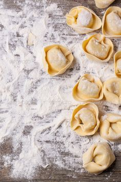 Pasta ravioli on flour ...  background, board, carbohydrate, closeup, cooking, cuisine, dinner, dough, dry, flour, food, fresh, gourmet, healthy, homemade, ingredient, italian, kitchen, lunch, making, meal, pasta, prepared, ravioli, raw, snack, stuffed, style, table, top view, tradition, traditional, typical, uncooked, view, white, wood, wooden, yellow