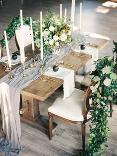 Romantic + rustic garland and floral covered table decor: Photography: Carretto Photo - http://www.carrettophoto.com/