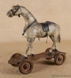 Athco composition horse pull toy, early C. Attached to an old roller skate. Antique Rocking Horse, Vintage Horse, Rocking Horses, Primitive Antiques, Vintage Antiques, Primitive Bedroom, Primitive Homes, Primitive Country, Wooden Horse