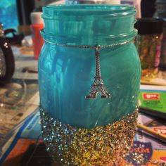 Decorated a bunch of mason jars from Walmart with Mod Podge, Glitter and paint as long with little trinkets from around the house! Super easy and fun! I made some for my college dorm room and my friends!