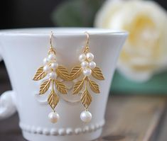 Hey, I found this really awesome Etsy listing at https://www.etsy.com/listing/106353308/gold-leaf-branch-earrings-white