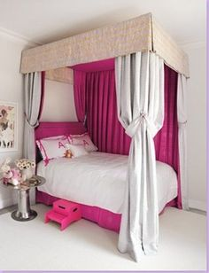 Apple Paltrow's room. Love the pop of bright pink and the canopy.