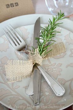 Simple place setting with fresh rosemary and burlap