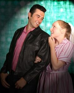 Kim MacAfee (Colleen Bielman of Troy) fawns over rock-n-roll star Conrad Birdie (Niko Bokos of Bloomfield Hills) before going on the Ed Sullivan show in the stage production of Bye Bye Birdie.