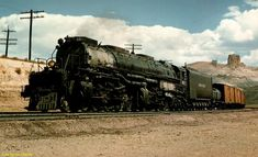 """Union Pacific 4-8-8-4 """"Big Boy"""" Locomotive 4017 and a westbound mixed manifest round a curve on the approach to Green River, WY. Photo by R. H. Kindig, 1957."""