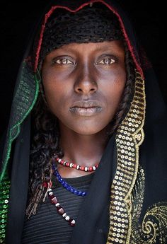 A girl from the Oromo tribe in eastern Ethiopia wears a striking, sequined headscarf (left). One day she will likely carry an umbrella to shield her from the sun like many older Oromo women. {Photographed by John Kenny} John Kenny, Black Is Beautiful, Beautiful World, Beautiful People, Photography Gallery, Portrait Photography, Fashion Photography, Wedding Photography, Foto Portrait