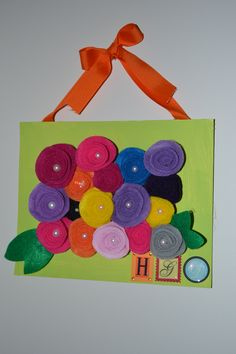 A 3D flower picrture frame I made for my 3 year old daughters room. Made with felt fabric flowers.