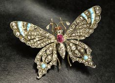 Butterfly brooch, France around 1870 with rubies, diamonds and turquoises