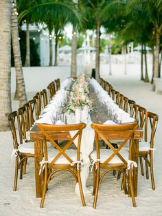 Long farm table for a beach reception by Care Studios.  #islabellaweddings #islabellaresort