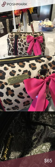 Betsey  Johnson bag Leopard print tote with shoulder strap. Large pink bow. Never used still has tag.  8Lx12Wx7D Betsey Johnson Bags Shoulder Bags