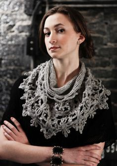 """Worn as a shoulderwarmer or a cowl, this floral crochet neckpiece is simultaneously warm and delicate. One size Finished Measurements Approximately 26"""" around top edge x 39"""" around lower edge x 17"""" high Materials 3 Hanks Berroco Flicker(50 grs), #3305 Siegfried Crochet hooks, sizes 3.75 mm (F-5) and 4.00 mm (G-6) OR SIZE TO OBTAIN GAUGE Tapestry needle Gauge Square Motif (top row) = 3½"""" across after steaming TO SAVE TIME, TAKE TIME TO CHECK GAUGE"""
