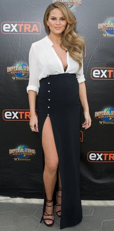 Chrissy Teigen is Maternity Chic in a Long skirt with buttons and a side slit
