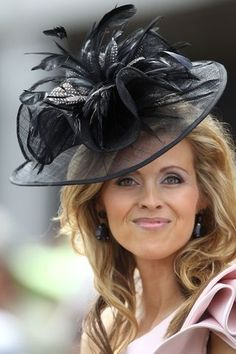 This is a terrific hat. But, she has too much hair and it diminishes the hat so it just looks perched like a bird's nest. The hair should never conflict with a fabulous hat. Tie it back.