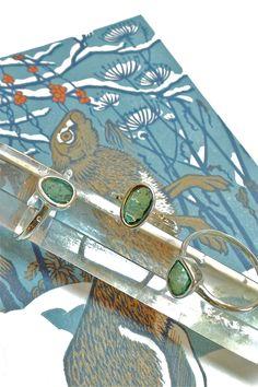Free Form blue tourmaline gemstones set in silver rings