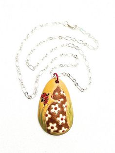 Cute pottery pendant necklace with a brown kitty greeting a ladybug!  #ceramic #pendant #cat by #UrbanClink, $44.00