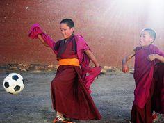 Tibetan child monks enjoy soccer in sunlight by Samer M, via Flickr