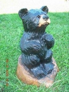 I don't say the word cute very often.   <---THIS CUTE.. chainsaw art