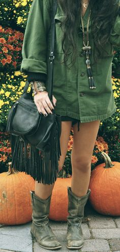 Oversized military style jacket, slouchy cowboy boots, fringed cross body, black nails & boho adornment. Love it all.