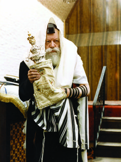the rebbe at 770 with his personal torah as is custom by all jewish kings to have their own torah scrool