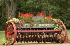 https://flic.kr/p/mJ7mF | Recycled | Old farm equipment used as a flower planter on great grandma's farm.
