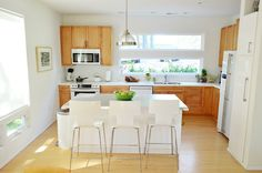 House Crashing: Sisterly Digs | Young House Love... how do I get my kitchen with wood cabinets and white appliances to look this awesome?!