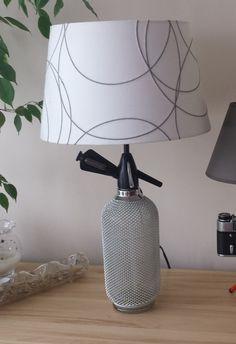 Lamp made of siphon. Siphon for water - glass in metal braid - 1970s. You are interested in buying - I invite you to contact :) www.facebook.com/ladnyprezent/ ladnyprezent@gmail.com  Lampa wykonana z syfonu. Syfon do wody - szklany w metalowym oplocie - lata 70 XX wieku. Jesteś zainteresowany zakupem - zapraszam do kontaktu :)