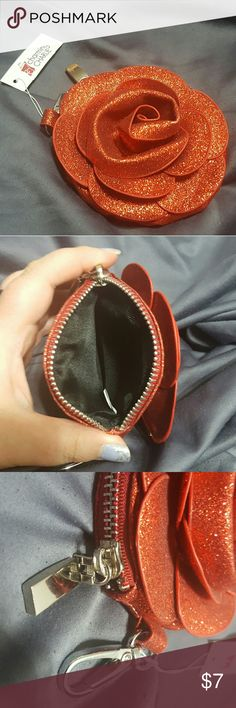 Small red rose change purse. NWT. Charming Charlie Small change purse. Red and glittery. Silver hardware including side zipper and purse clip. Never used. Charming Charlie Bags Wallets