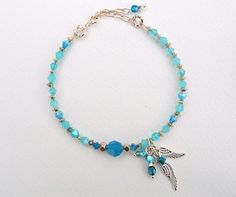 Angel Wing Bracelet, Vibrant Bahama Blue Swarovski Elements Crystals, Karen Hill Tribe Faceted Silver Nuggets and Delicate Angel Wings