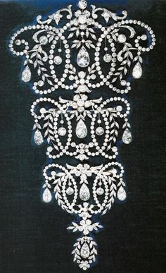 Queen Mary's Stomacher 8 inches long, given to the Queen by Queen Mary in 1947 as a wedding gift. These were popular when women wore corsets, but now the Queen only wears one of the 3 sections of this piece.