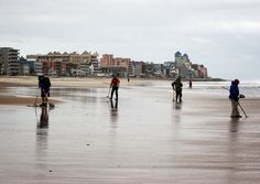 People participate in metal detecting at the beach after Hurricane Sandy hit the region October 30, 2012 in Ocean City, Maryland.