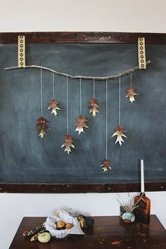 DIY Giving Thanks Golden Leaf Garland...have to do this at Thanksgiving! What a wonderful tradition it would make, too--the branch would grow more leaves every year!