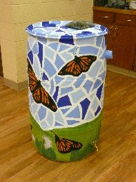 I need to paint my rain barrel.  Well, first I have to BUY a rain barrel.  Then paint it.  I mean I will ask Cort to paint it...