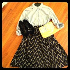 "Retro city chic! Chevron- blue, black, and grey high waist skirt.. So darlin dress up or down.. Super cute for a dinner date with your girlfriends.. Or for work waist is 25"" length is 261/2"".. Tag says vintage 9... I say it will fit and xs.. 2nd pic shows flaws not noticeable.. Also has pockets Dresses"