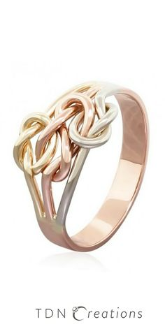 This gold triple knot ring features a center figure 8 knot with 2 love knots connected to it.