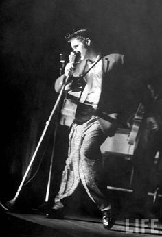 Elvis. Moving hips. And leg. The left one.