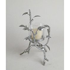 @Overstock - Wrought iron candle holder will add dramatic flair to your home decor  Decorative accessory features a leaf patten with a glittery silvertone finish  Holder has a glass insert for votive or tea light candleshttp://www.overstock.com/Home-Garden/Small-Silvertone-Leaf-Candle-Holder/3999587/product.html?CID=214117 $15.72