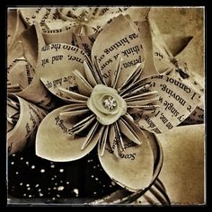 Forever Paper Flowers vintage book page flower bouquet. We can make you bespoke bouquets, centrepieces, buttoniers, pomanders and anything else you can dream up exactly to your specification. Find us on Facebook, Pinterest, Instagram and our website all under the name Forever Paper Flowers.