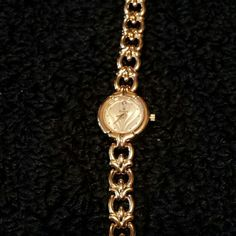Bulova gold watch with Diamond accent Bulova gold plated watch with Diamond accent on the 12.  beautiful swirl face. Extra links included. Fine jewelry. Diamond weight is less than 1/10. 7 1/2 inches in length. Links need to be added in otherwise length is 6 inches. Bulova Accessories Watches