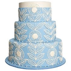 Pretty blue cake with delicate floral piping cover this cake.