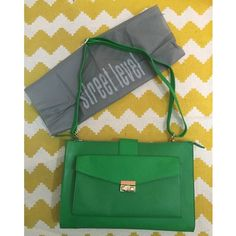 """Street Level Green Faux Leather Bag NWOT Street Level brand green satchel. New without tags. Bought at small boutique. Excellent condition. Strap can be adjusted to make it a shoulder bag or crossbody bag! Remove the strap to make it into a clutch! Pocket on the outside. Zippered pocket inside with 2 other open pockets. Gold accents. Cute triangle print lining inside. Comes with storage bag as seen in picture. 100% polyurethane. Proximate measurements: W 2"""" x H 9"""" x L 13.5"""" Street Level Bags…"""
