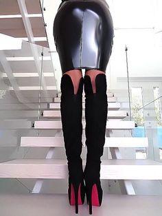 Tight black latex skirt bottom and OTK boots