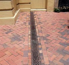 French Drain, to prevent water/melting ice from following into garage.