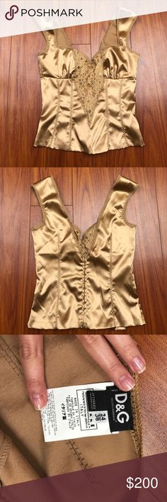 Authentic Dolce and Gabbana corset top Brand new without tags. Bought in Europe. Authentic D&G corset top. Zipper closure on the back Dolce & Gabbana Tops Camisoles